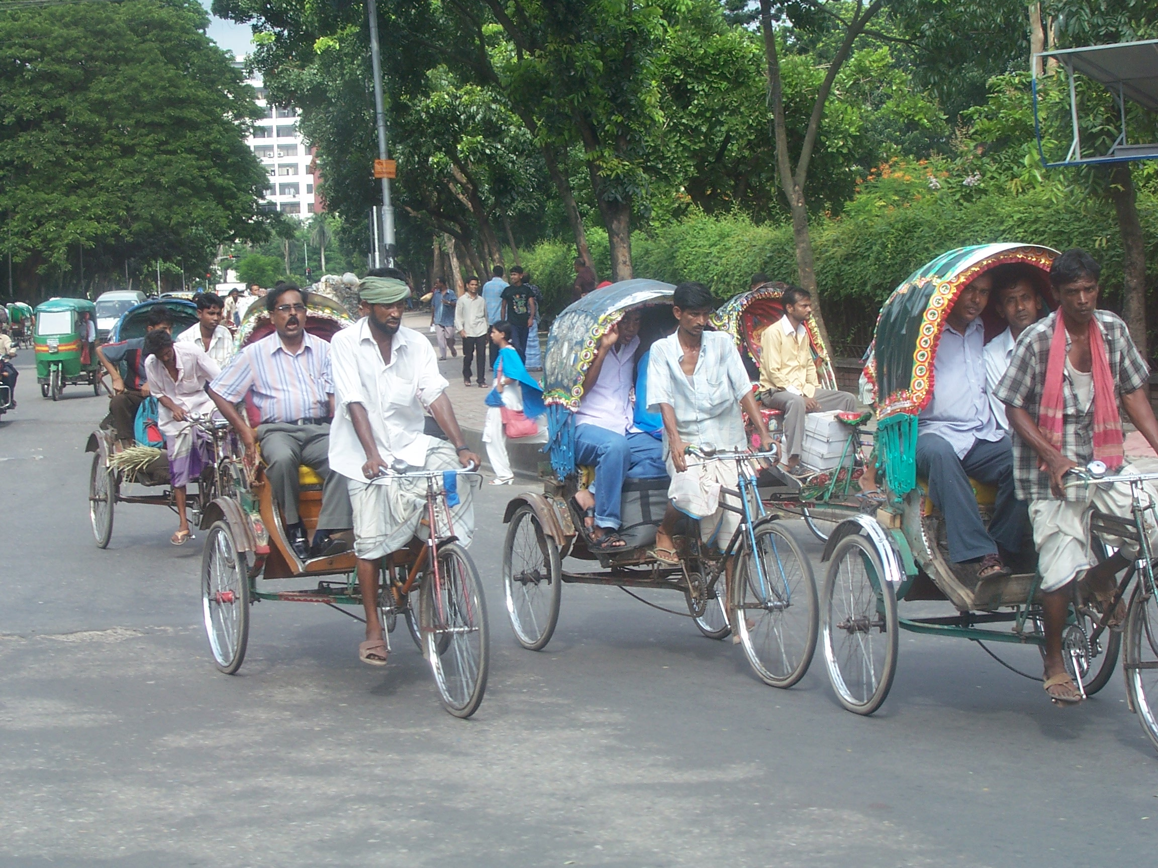 A group of bike carts and riders