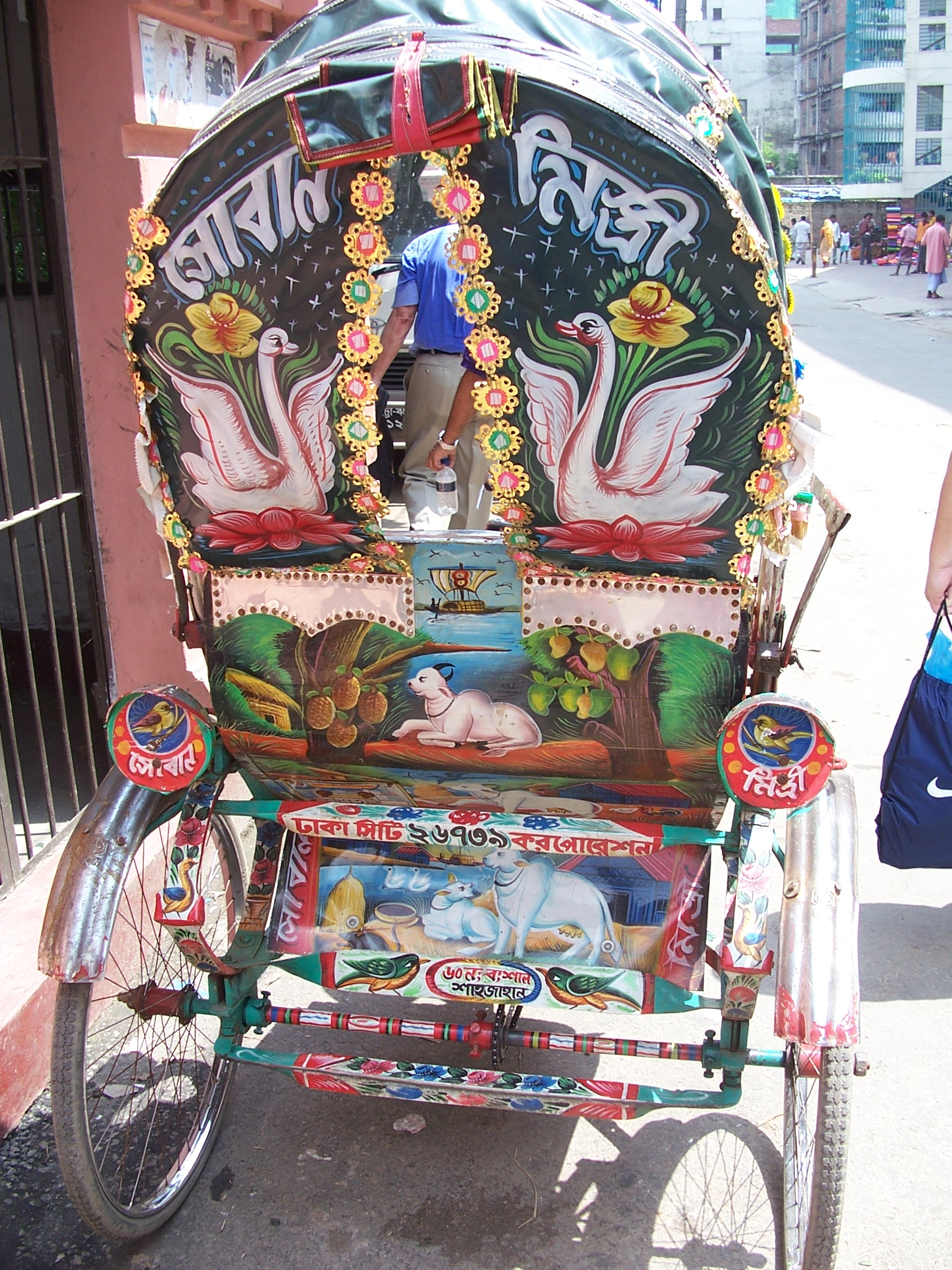 The back of an elaborately decorated bike cart