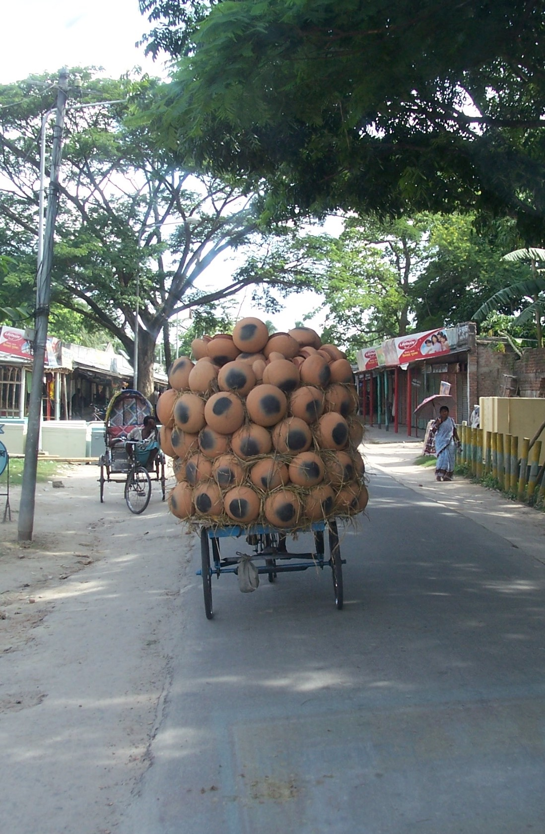 A man transporting his gourds on a cart