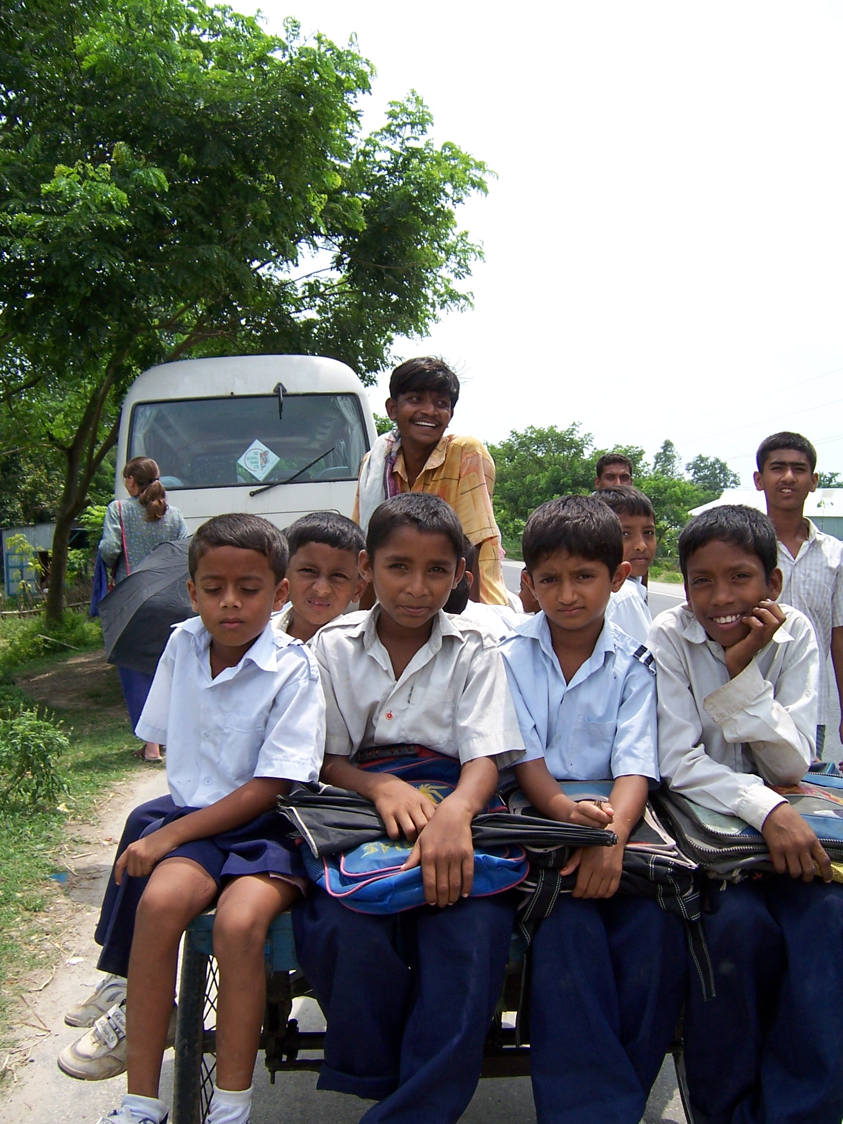A group of boys traveling on a cart
