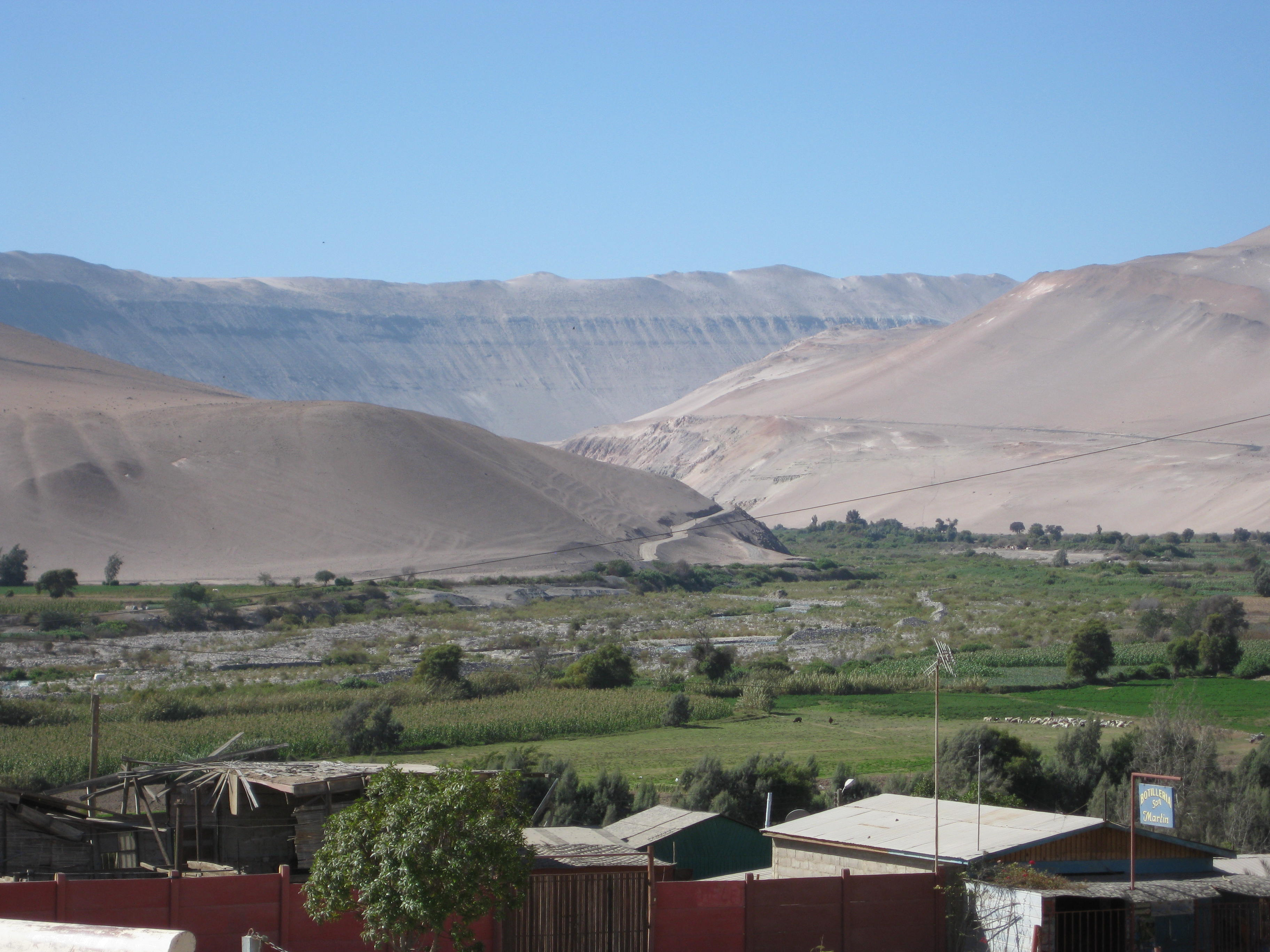 A view of the green valley and the brown dessert