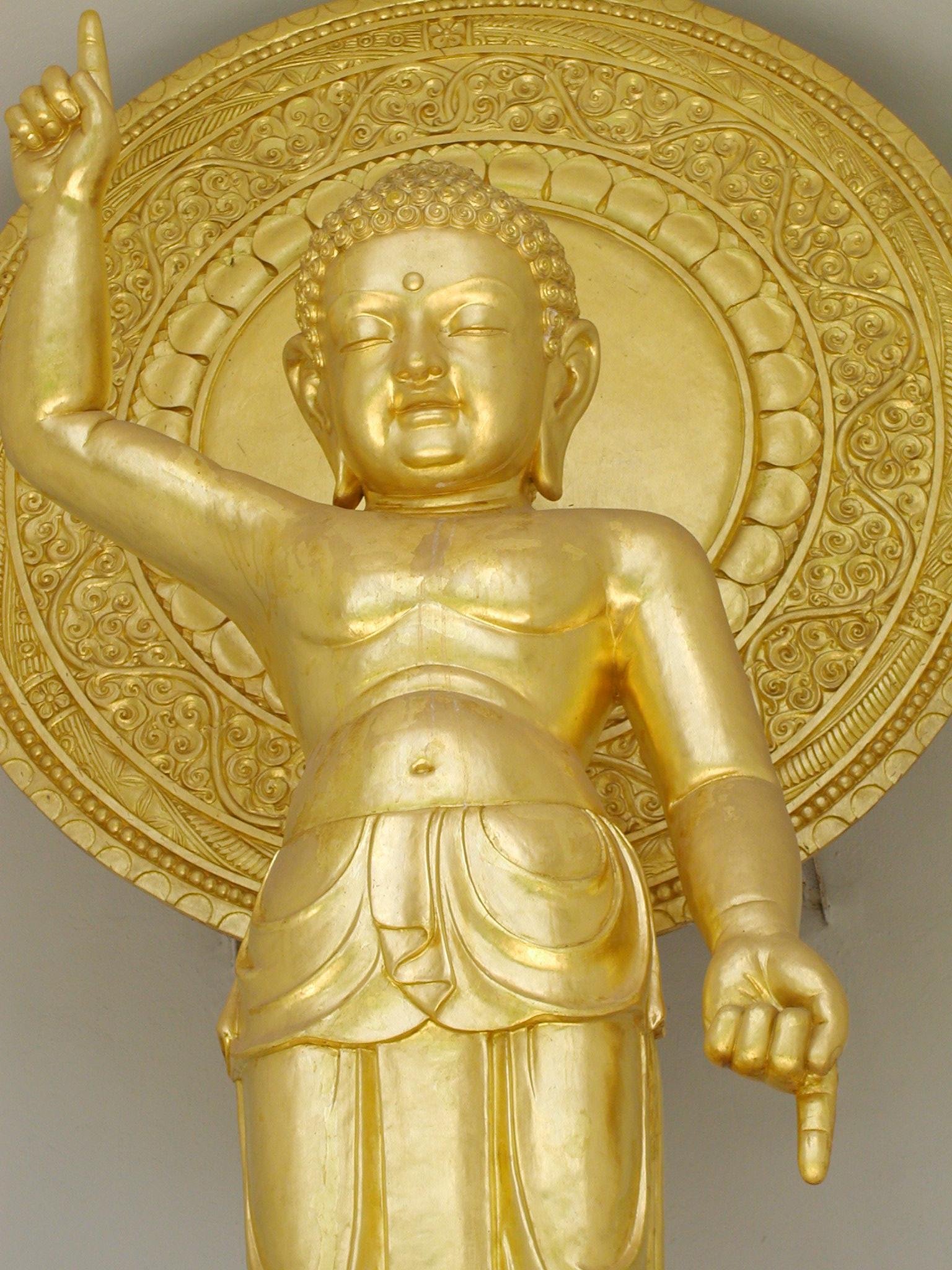 A gold statue inside a Buddhist stupa