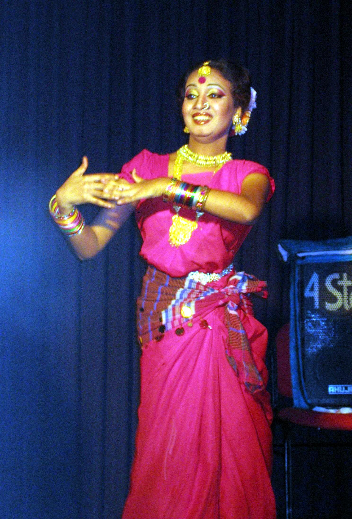 A women dances in traditional dress
