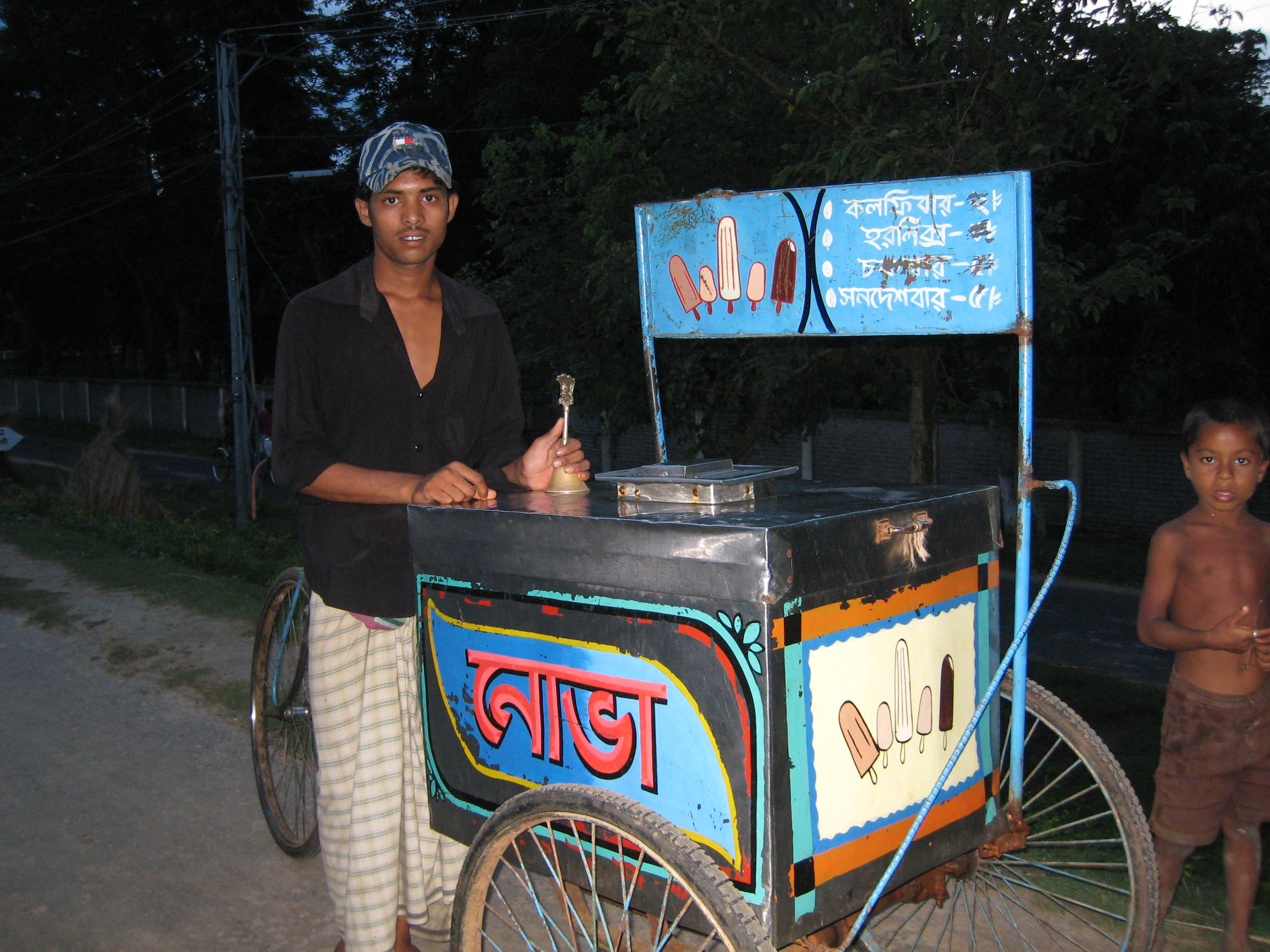 A man selling at his ice cream cart