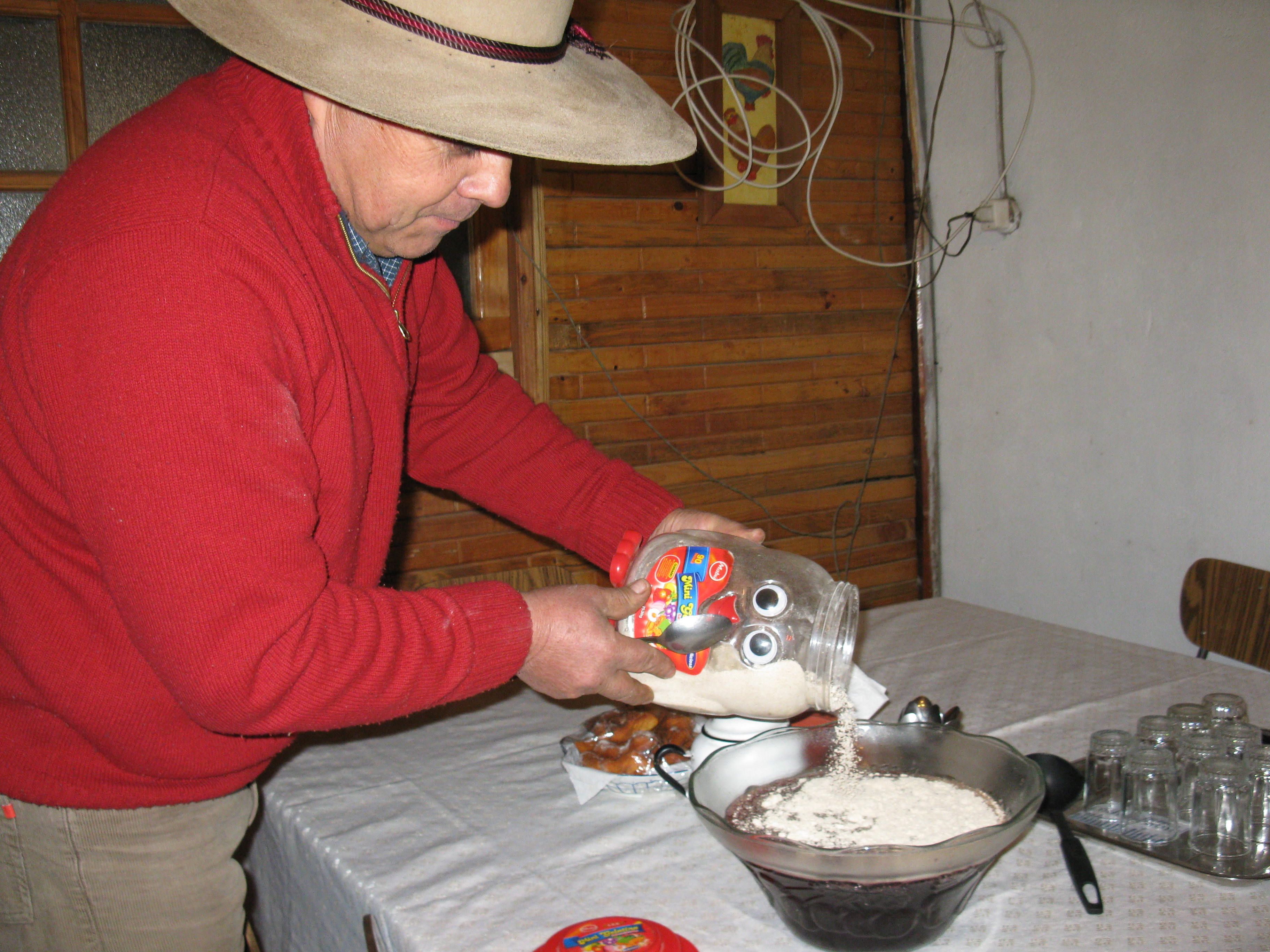 """Man making a traditional rural Chilean  """"working person"""" breakfast"""