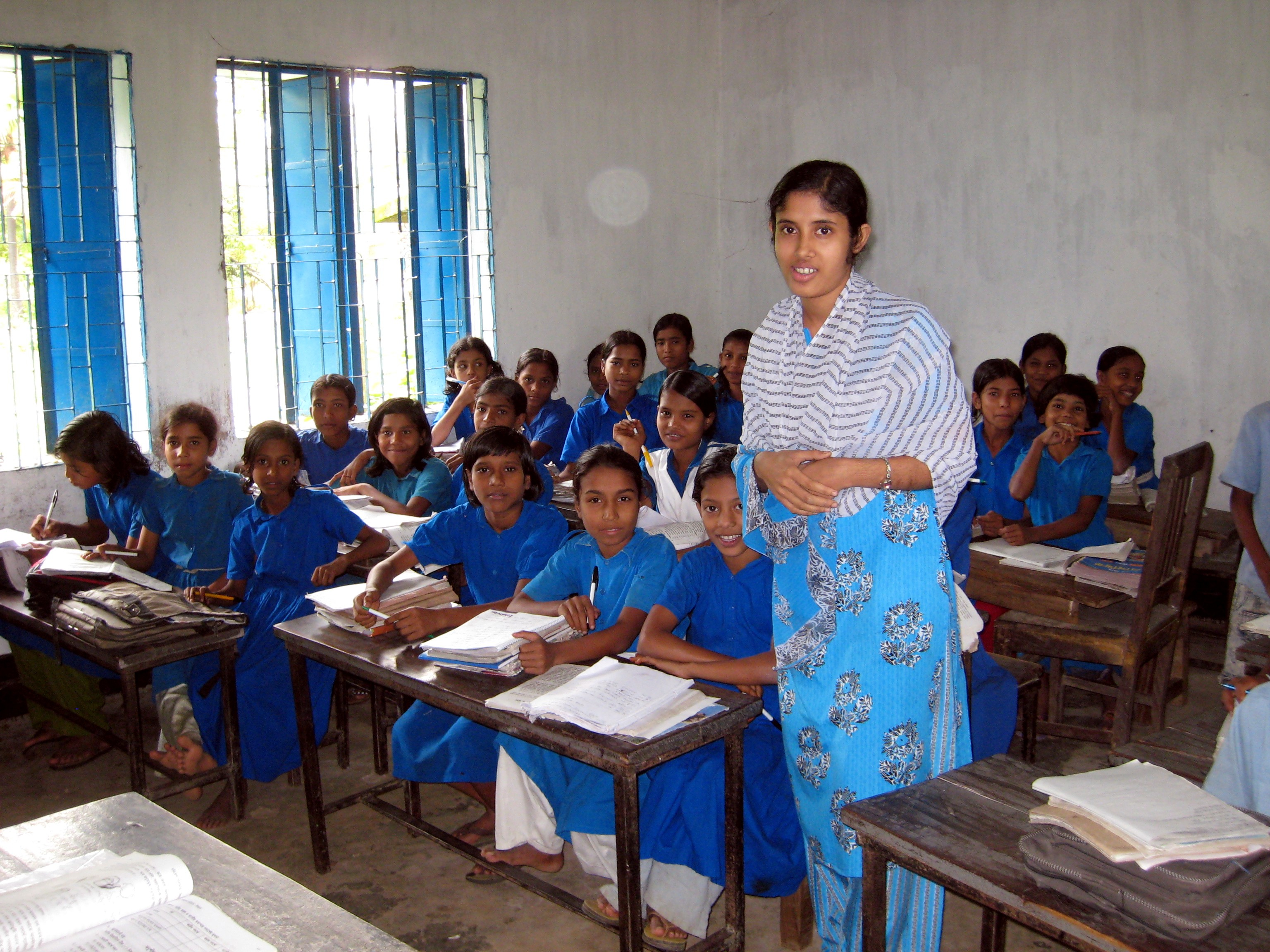 A teacher and her students in their classroom