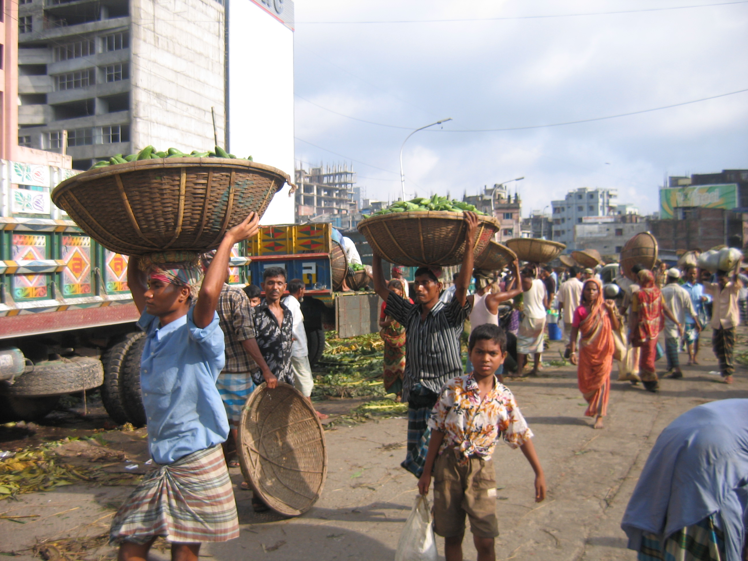 Locals carrying their goods in baskets on their head