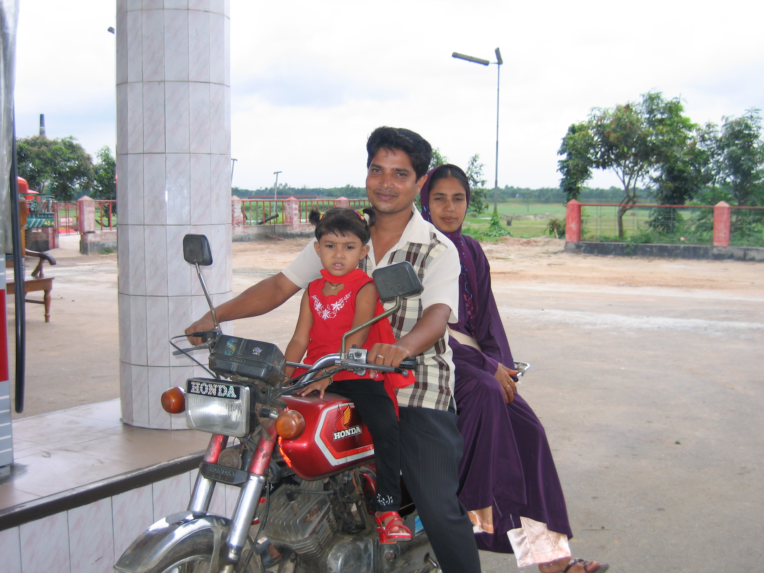 A family of three on a motorcycle